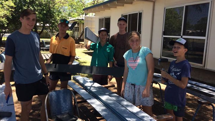 Some willing workers painting the trays from the back of the church pews. Thanks…